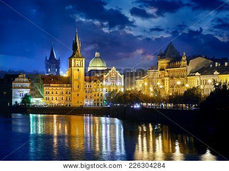 Evening over river Vltava near Charles bridge in Prague, Czech republic.