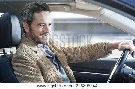 An Handsome Man Driving In His Car