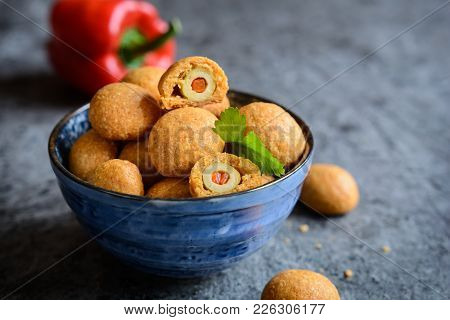 Baked Olives In Cheese And Paprika Dough