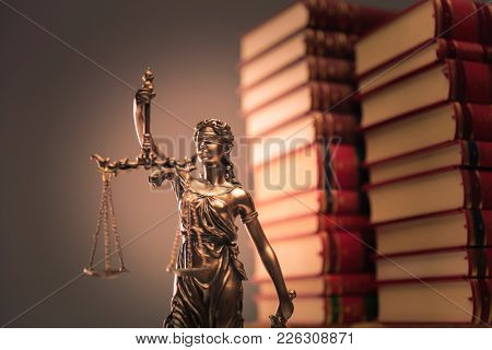 law books and justice statue shot in studio