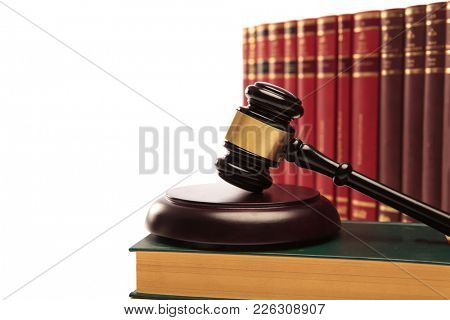 judge's gavel on a law book and many books in the background