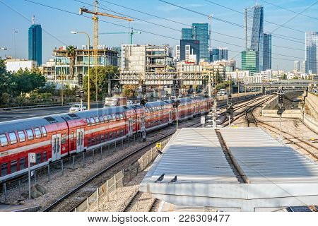 Tel Aviv, Israel - November, 2016: View To The Railway Station And Red Train Over New Skyscrapers In