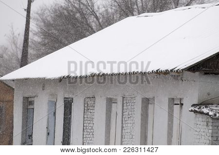 Snow On The Roof. Blizzard