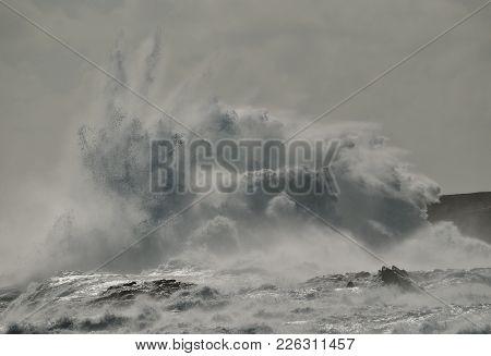 Big Wave Breaking Against The Rocks, Coast Of Gran Canaria, Canary Islands