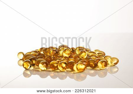 Vitamin Omega-3 Fish Oil Capsules Isolated On White Background With Copy Space. Cod Liver Oil Pills,