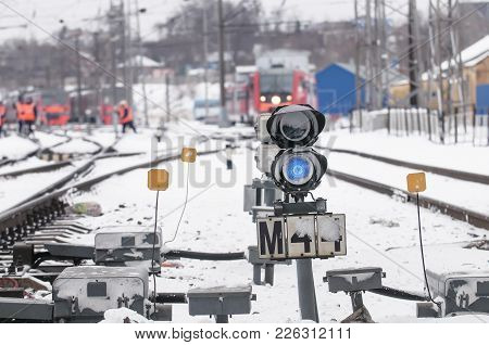 Railway Traffic Light, Blue, During A Blizzard.