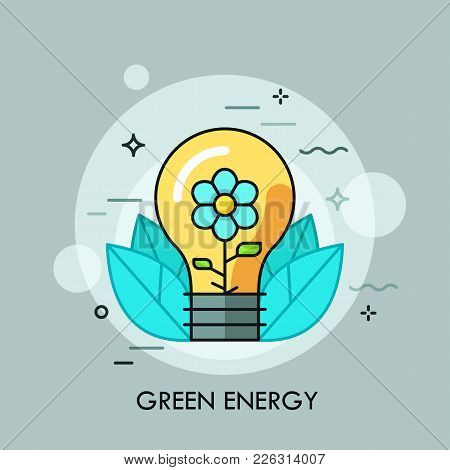 Light Bulb With Blooming Flower Inside It And Leaves. Concept Of Green Energy, Ecologically Friendly