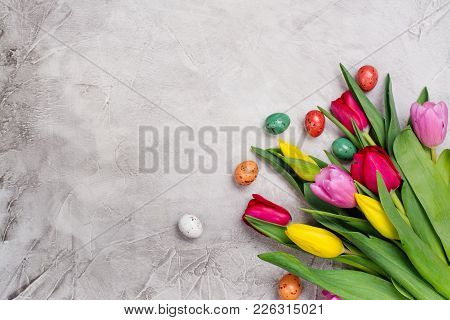 Bunch Of Spring Bright Tulips In Galvanized Watering Pot And Easter Eggs. Copy Space