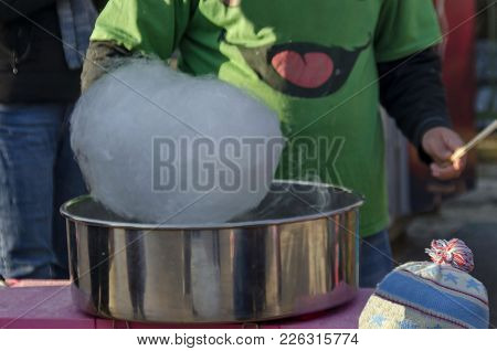 Making Cotton Candy In Metal Container At Park, Sofia, Bulgaria