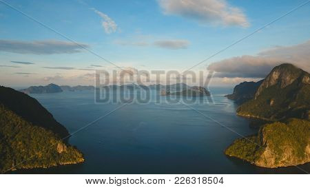 Tropical Bay In El Nido. Aerial View: Bay And The Tropical Islands. Tropical Landscape. Sky And Moun