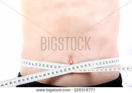 Teenage Boy Measuring His Waist Isolated On White
