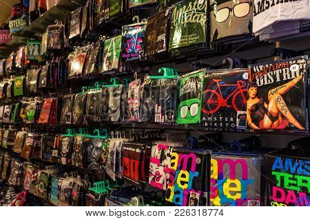 Amsterdam, The Netherlands - June 10, 2014: Packed Souvenir T-shirts In Shop In Amsterdam. Amsterdam