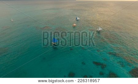 Aerial View: Boracay, Sunset Over The Sea In The Background Boats, Sailing Boat, Orange Sky And Isla