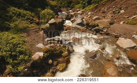 Landscape With Lush Forest And A River Flowing Through Mossy Boulders, Camiguin. Aerial View: Mounta