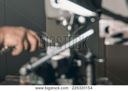 Blurred Employee Drilling. Metal Drilling. Metal Workshop.