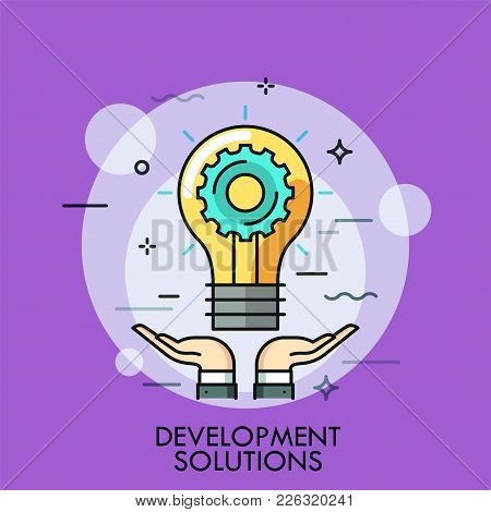 Hands And Glowing Light Bulb With Gear Wheel Inside. Concept Of Development Solution, Idea Creation,