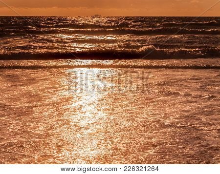 Gentle Waves On The Beach, Golden Warm Colors During The Evening