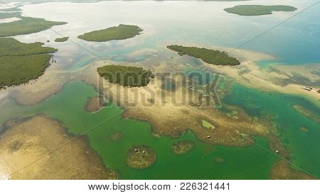 Aerial View: Beach, Tropical Island, Sea Bay And Lagoon, Bohol. Tropical Landscape Hill, Clouds And