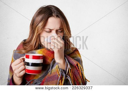 Pretty Sick Woman Has Runnning Nose, Rubs Nose With Handkerchief, Drinks Hot Beverage, Wrapped In Wa