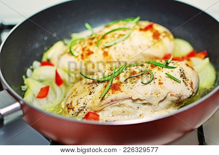 Pan Seared Chicken Breasts With Onions And Spices Cooking In Frying Pan