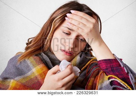 Allergic Woman Has Headache Because Of Blocked Nose, Keeps Hand On Forehead, Has High Temperature, F