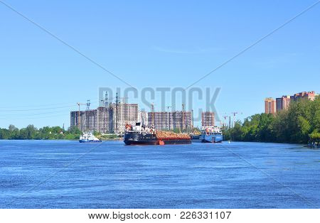 Cargo Ship On The Neva River, Outskirts Of St.petersburg At Sunny Summer Day, Russia.