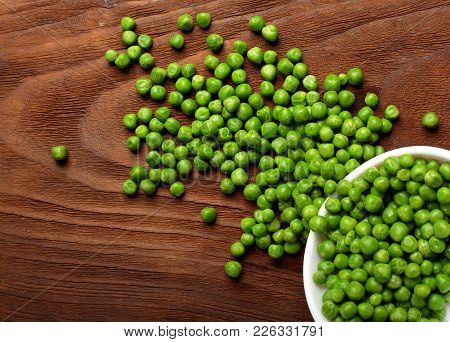 Green Peas.in White Bowl.on Wooden Background, Table.top View .copy Space
