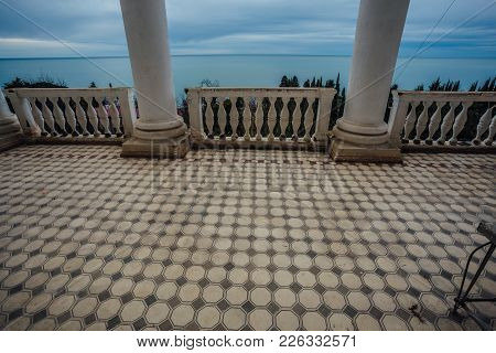 Ornamental Tiled Wall And Balcony With Column At Abandoned Mansion.
