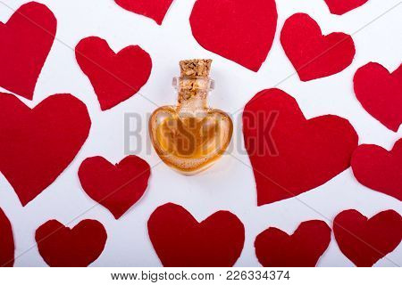 Bottle In Heart Shape Icons As Love Concept