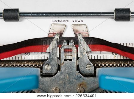 Macro Detail Of The Ink Ribbon And Text Of Electric Typewriter With Words Latest News