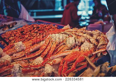 A Large Showcase With Claws And Parts Of The North Sea Crab And Shrimp On The Counter Of The Norwegi