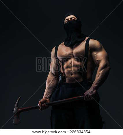 Muscular Male In Mask Holding Axe. Isolated On Grey