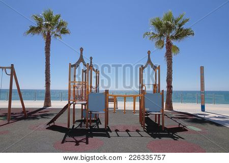 Horizontal View Of A Kids Playground In A Viewpoint With Sea Views In The City Of Cadiz, Spain