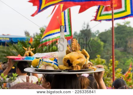 Quang Ninh, Vietnam - Mar 22, 2015: Vietnamese People Bring Offerings To Cai Bau Temple . Visiting P