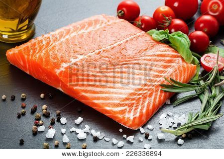 Raw Salmon Fillet With Various Vegetables On Slate