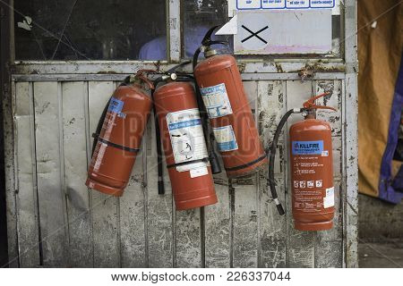 Hanoi, Vietnam - Aug 28, 2015: Fire Extinguishers Hung On Old Security House At Long Bien Market