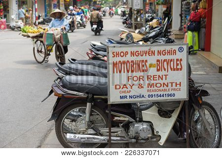Hanoi, Vietnam - Apr 5, 2015: Advertising Sign Plate Motorbikes For Rent In Hang Bac Street. Motorbi