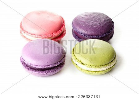 Four French Macarons Isolated On White Background