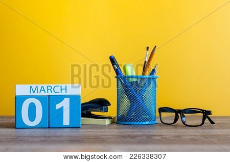 March 1st. Day 1 Of March Month, Calendar On Table With Yellow Background And Office Or School Suppl