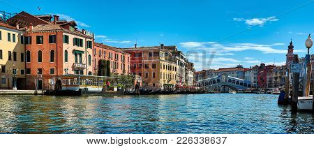 Venice, Italy - May 21, 2017: Beautiful View Of Old Buildings, Gondolas And The Rialto Bridge From A