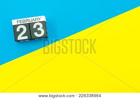 February 23rd. Day 23 Of February Month, Calendar On Blue And Yellow Background Flat Lay, Top View.