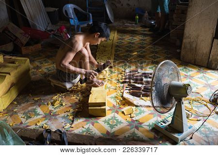 Dong Anh, Hanoi, Vietnam - Sep 20, 2015: Asian Male Worker Make Wood Carving In Very Small And Narro