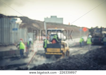 Blurred Working Yellow Ride On Roller Asphalt Compactor