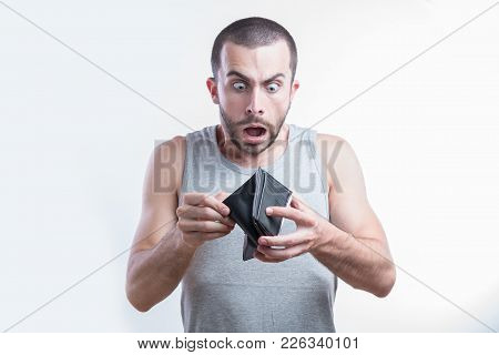 Broke Man Gasping In Shock When He Sees He Has No Money In His Wallet