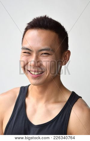 A Smiling Asian Chinese Male Facing The Camera