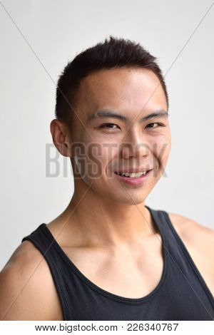 A Portrait Of A Smiling Asian Chinese Male