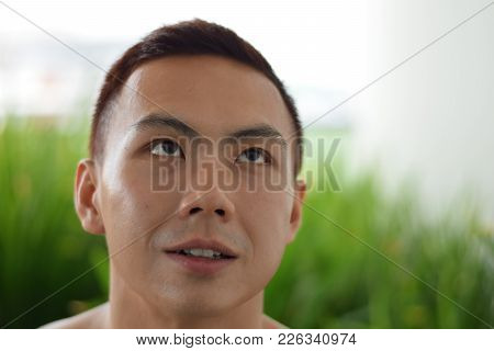 A Headshot Of An Asian Chinese Man Looking Up
