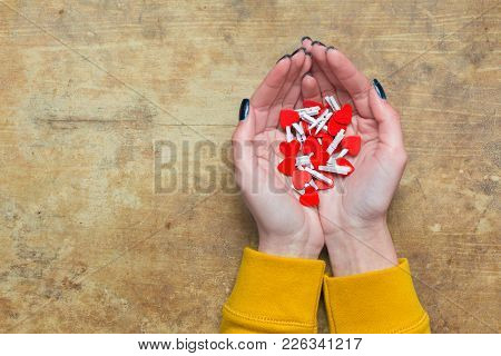 Female Hands With Red Hearts On A Wooden Table, Red Hearts Pegs