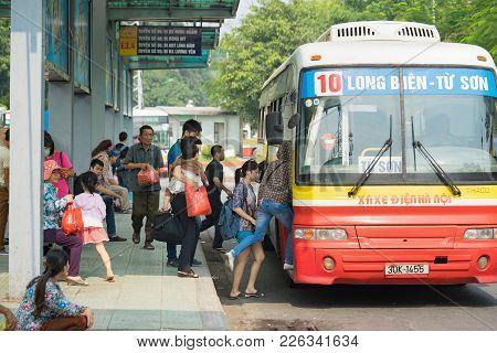 Hanoi, Vietnam - Oct 25, 2015: People Boarding Bus At Station In Hanoi City