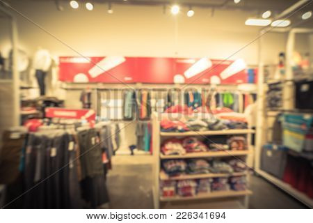 Blurred Clearance Section At American Clothing Retail Store